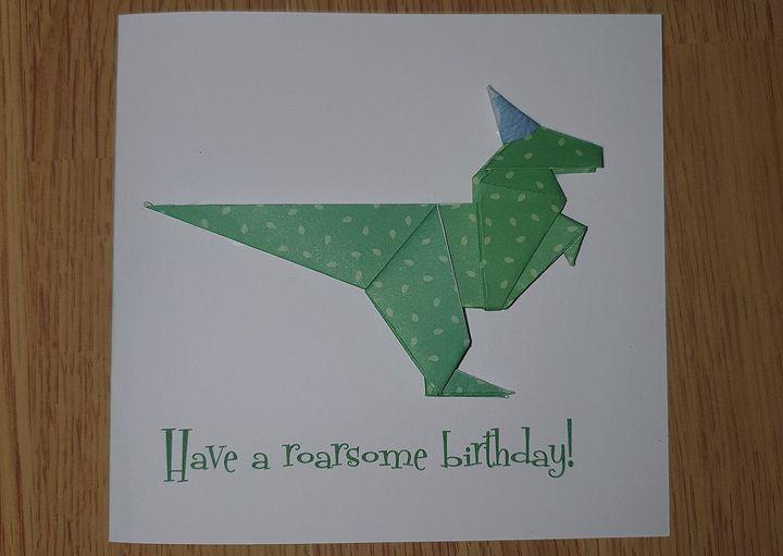 Карточка с оригами-динозавром